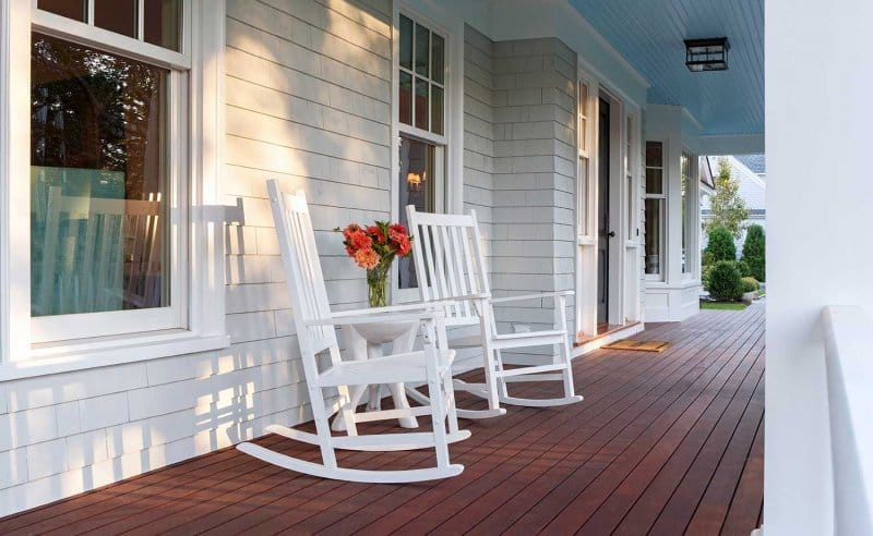 White chairs on the front porch of a house (Photo by David Papazi an via gettyimages.com)