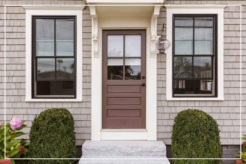 chocolate brown color front door  (Photo by dpproductions/iStock/Getty Images Plus via Getty Images)