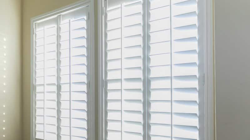 Close-up of open white estate shutters (Photo by ucpage/iStock / Getty Images Plus via Getty Images)