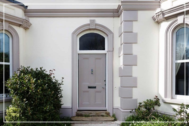 cobblestone gray front door  (Photo by nicolamargaret/iStock/Getty Images Plus via Getty Images)