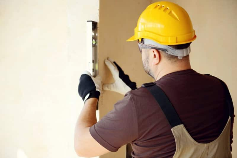 Contractor working on house (Photo by elenaleonova / iStock / Getty Images Plus via Getty Images)