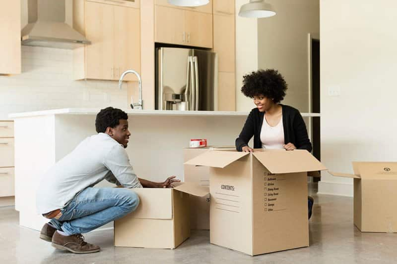 Couple packing moving boxes (Photo by Roberto Westbrook via Getty Images)