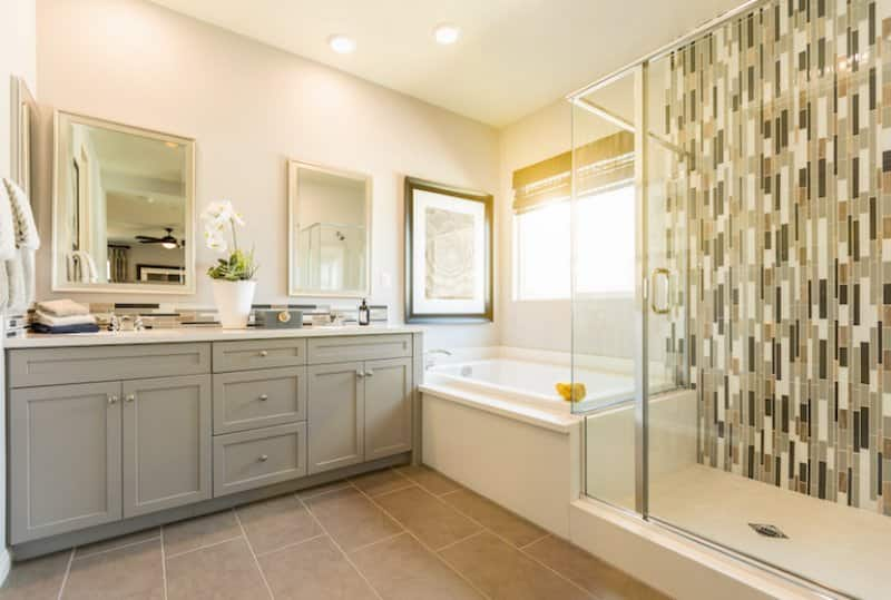 a custom bathroom with a bathtub and shower side by side (Photo by © Andy Dean - stock.adobe.com)