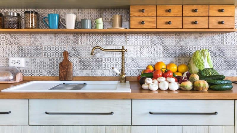 Detail of a rustic kitchen with vegetables on the countertop (Photo by borcee/E+ via Getty Images)