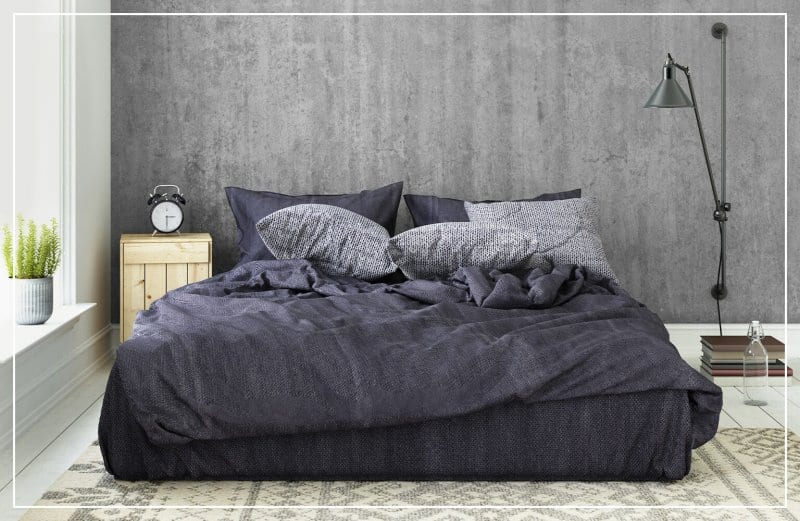 faux concrete wall in bedroom  (Photo by ExperienceInteriors / E+ via Getty Images)