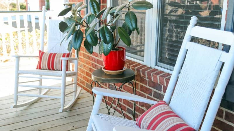A closeup of a front porch with two rocking chairs (Photo by Daniela Dunkan/ Moment via Getty Images)