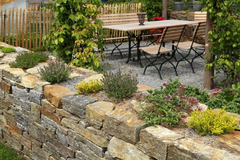 Stone wall with plants (Photo by BasieB / iStock / Getty Images Plus via Getty Images)