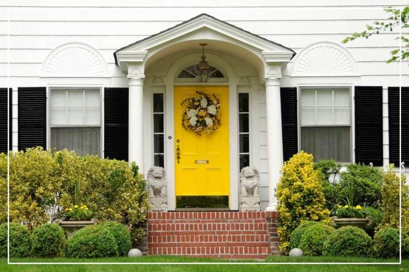 golden yellow front door  (Photo by SondraP/iStock/Getty Images Plus via Getty Images)