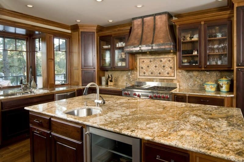 Granite island and counter (Photo by chandlerphoto / E+ via Getty Images)