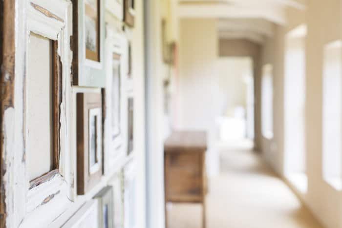 Hallway with photos hanging on wall.