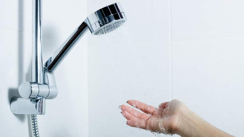 A handheld shower head (Photo by Andrii Atanov/iStock / Getty Images Plus via Getty Images)