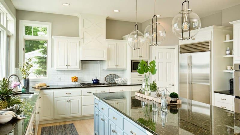 High contrast black, light blue and white kitchen (Photo by YinYang / E+ via Getty Images)
