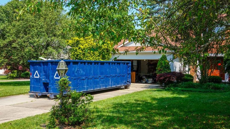 Dumpster in front of house (Photo by ALAN - stock.adobe.com)
