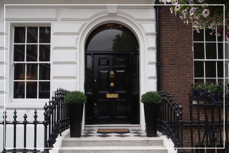 jet black color front door  (Photo by peterspiro/iStock/Getty Images Plus via Getty Images)