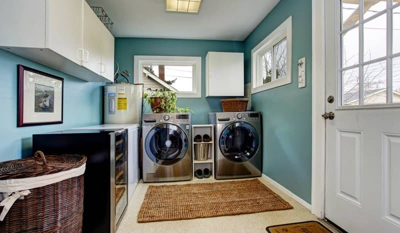 Laundry room with washer, dryer and water heater (Photo by Iriana Shiyan - stock.adobe.com)