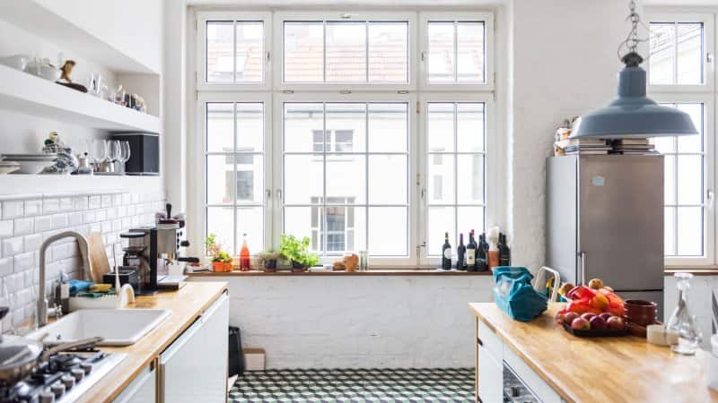 A bright kitchen in a loft apartment (Photo by Hinterhaus Productions/DigitalVision via Getty Images)