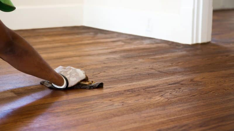 A man refinished a hardwood floor (Photo by digitalskillet1 - stock.adobe.com)