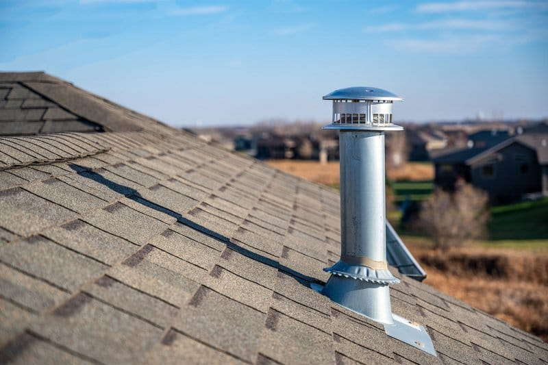 roof with chimney cap (Photo by Lost_in_the_Midwest - stock.adobe.com)