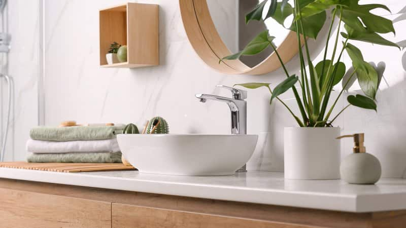 Close-up of a modern bathroom faucet (Photo by New Africa - stock.adobe.com)