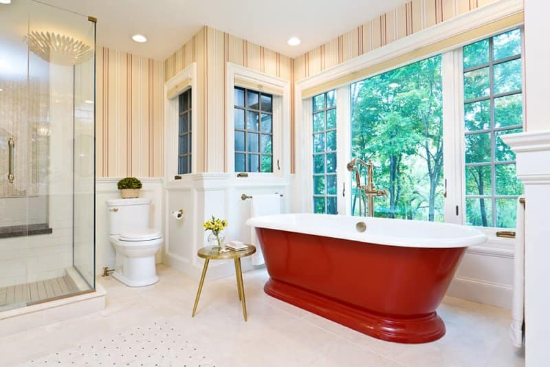 Contemporary bathroom with freestanding red bathtub (Photo by YinYang/E+/Getty Images)