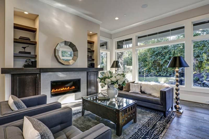 Modern living room with gas fireplace (Photo by irina88w/iStock/Getty Images Plus/Getty Images)