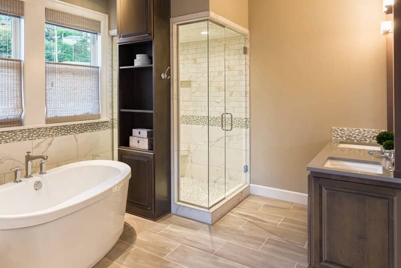 Modern luxury bathroom with vinyl flooring (Photo by hikesterson/iStock/Getty Images Plus via Getty Images)
