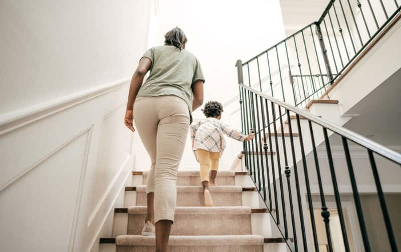 Mother and daughter going upstairs at home (Photo by kate_sept2004/E+ via Getty Images)