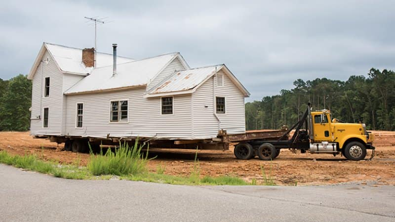 Transporting a house by truck (Photo by Becky Wright - stock.adobe.com)