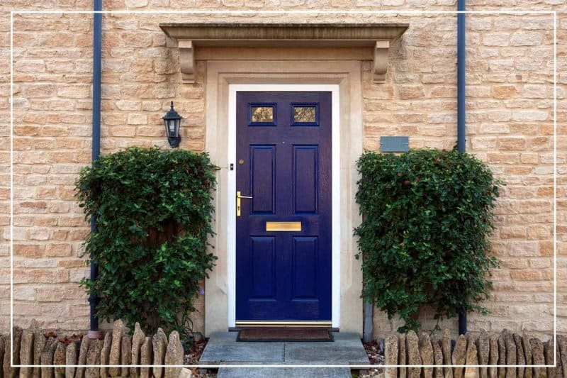 navy blue front door  (Photo by ChrisAt/iStock/Getty Images Plus via Getty Images)