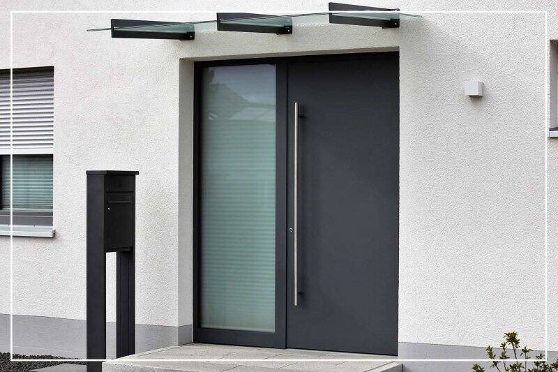 off-black color front door  (Photo by Palatinate Stock/Shutterstock.com)