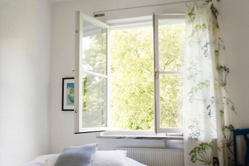 Open bedroom window (Photo by ZenShui/Sigrid Olsson/PhotoAlto Agency via Getty Images)