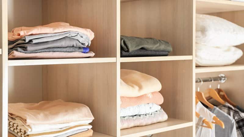 Detail of an organized closet with clothes (Photo by Africa Studio - stock.adobe.com)