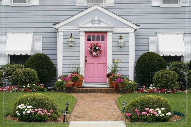 pastel pink-painted front door  (Photo by Joy Brown/Shutterstock.com)