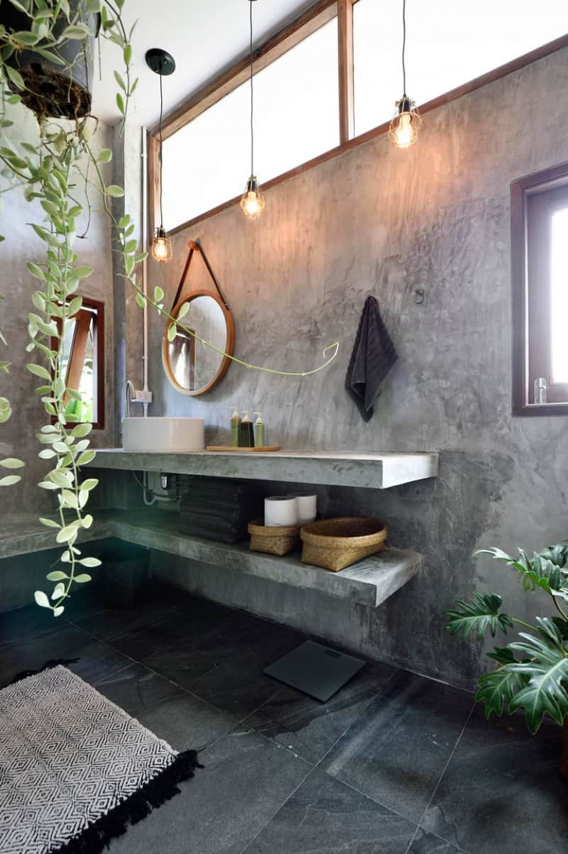 modern bathroom with hanging plant  (Photo by Carlina Teteris/Moment via Getty Images )