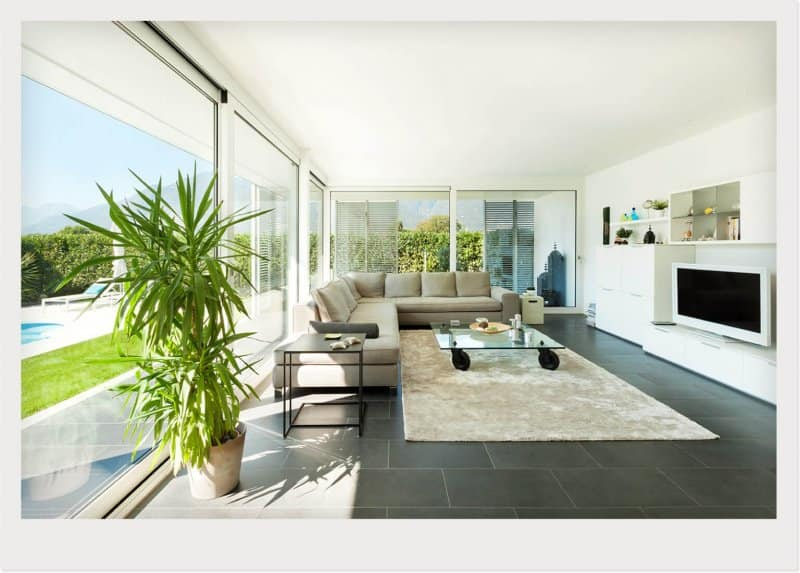 poolside sunroom with couch and TV (Photo by © Alexandre Zveiger/Shutterstock)
