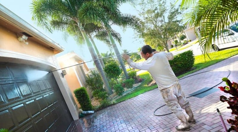 professional power washes a fancy California home (Photo by Jodi Jacobson / E+ / Getty Images)