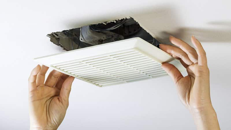 Detail of a professional's hands while installing an exhaust fan (Photo by tab62 - stock.adobe.com)