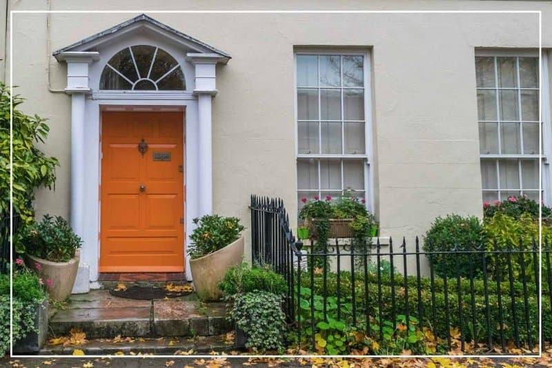 pumpkin orange front door  (Photo by vicentegarridoj/Shutterstock.com)