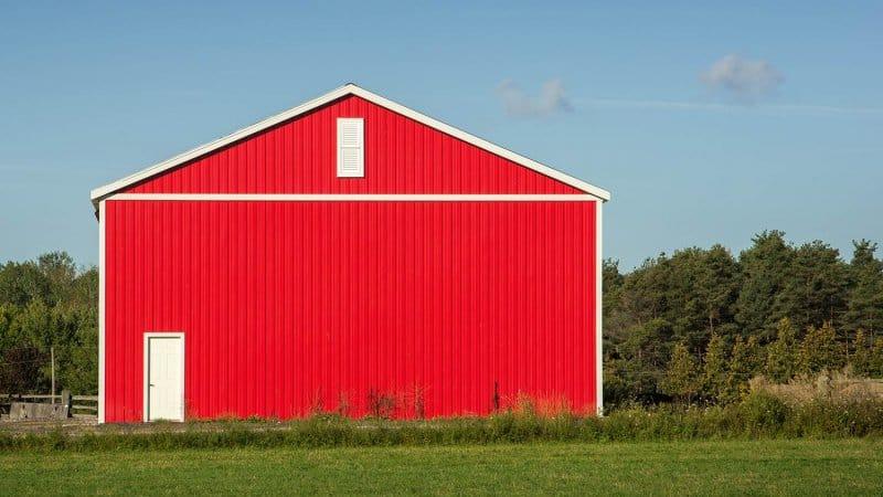 Red metal barn (Photo by Les Palenik - stock.adobe.com)
