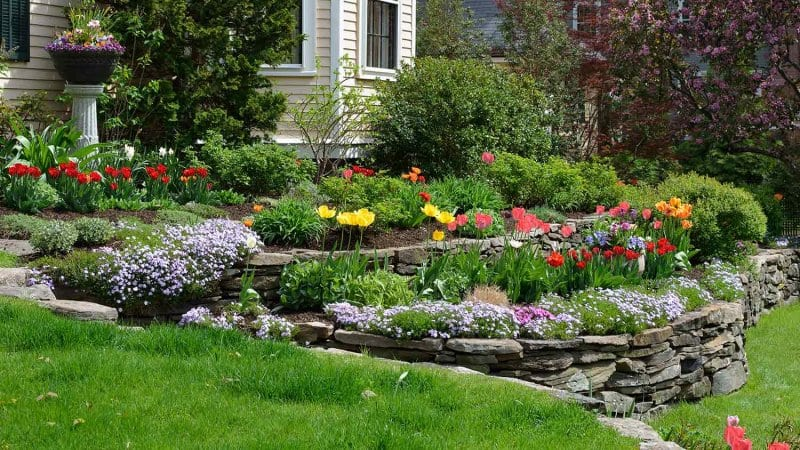 Hillside landscaping with retaining wall (Photo by jStock - stock.adobe.com)