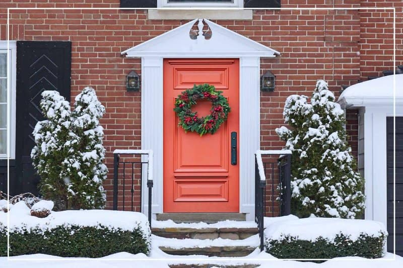salmon color front door  (Photo by Peterspiro/iStock/Getty Images Editorial via Getty Images)