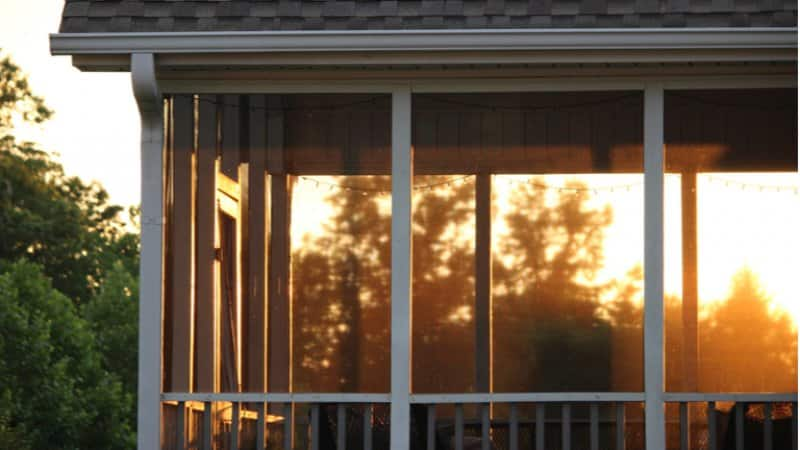 Close up of screened in porch during a sunset (Photo by uni_hannah_corn/Shutterstock.com)