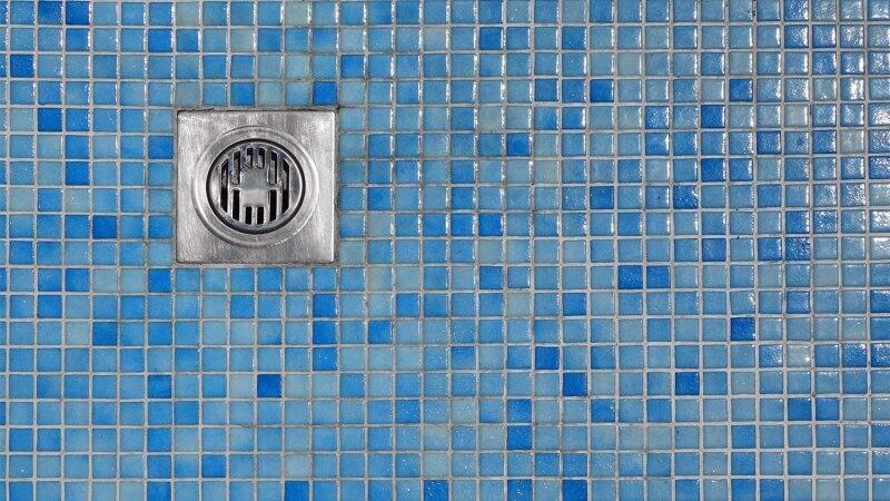 Blue tiled floor shower drain (Photo by  Alex - stock.adobe.com)