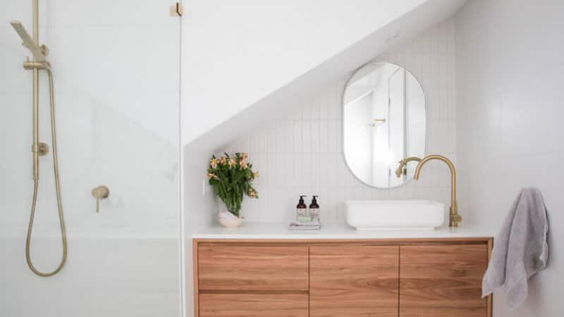 bathroom with shower, sink, and mirror