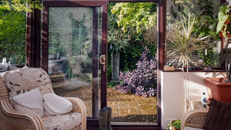 A sliding door leading to a house's patio (Photo by Pauline Lewis/Moment via Getty Images)
