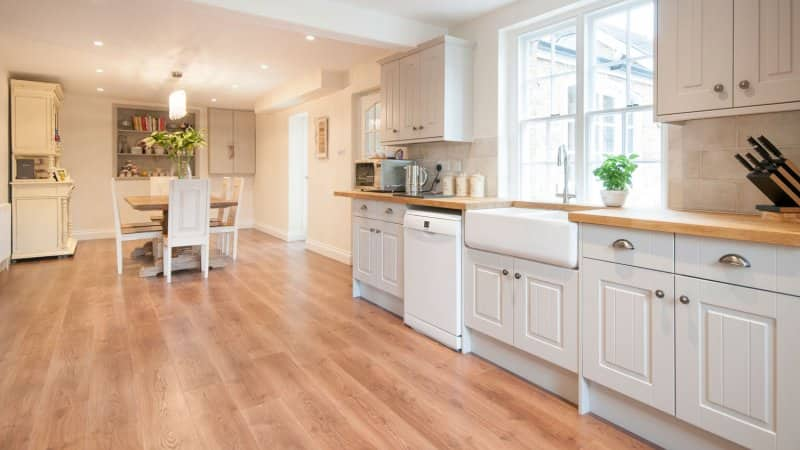 A spacious kitchen with white cabinets (Photo by John Keeble/Moment via Getty Images)