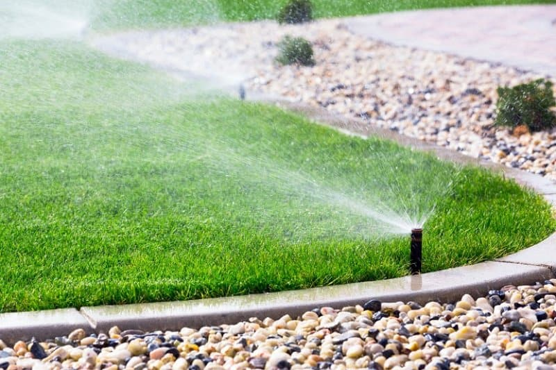 Sprinklers watering lawn (Photo by © MariuszBlach / iStock / Getty Images Plus / Getty Images)