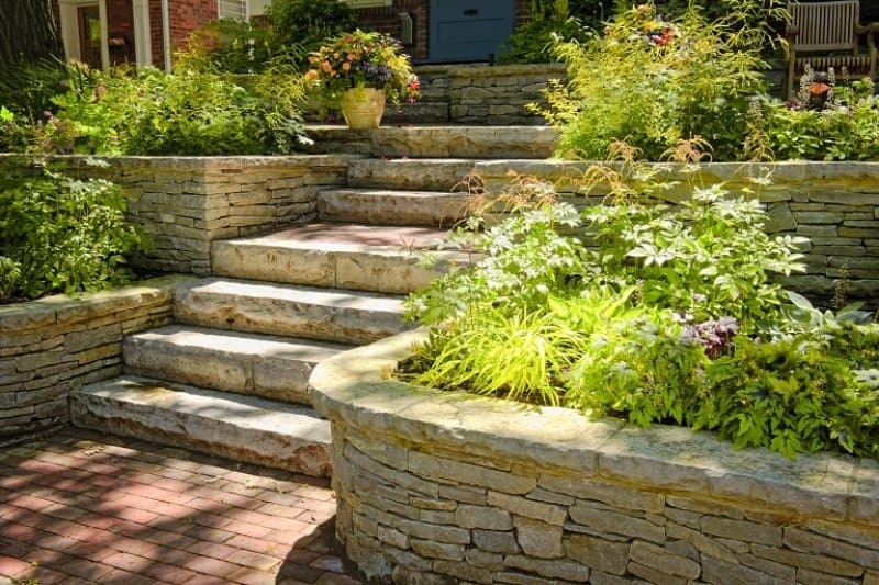 Natural stone steps with planters  (Photo by ©  Elenathewise - stock.adobe.com)
