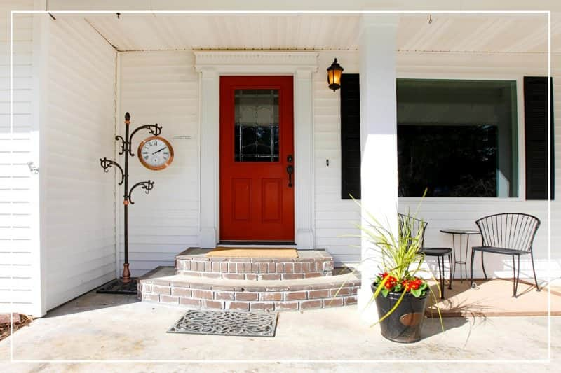 strong red color front door  (Photo by irina88w/iStock/Getty Images Plus via Getty Images)
