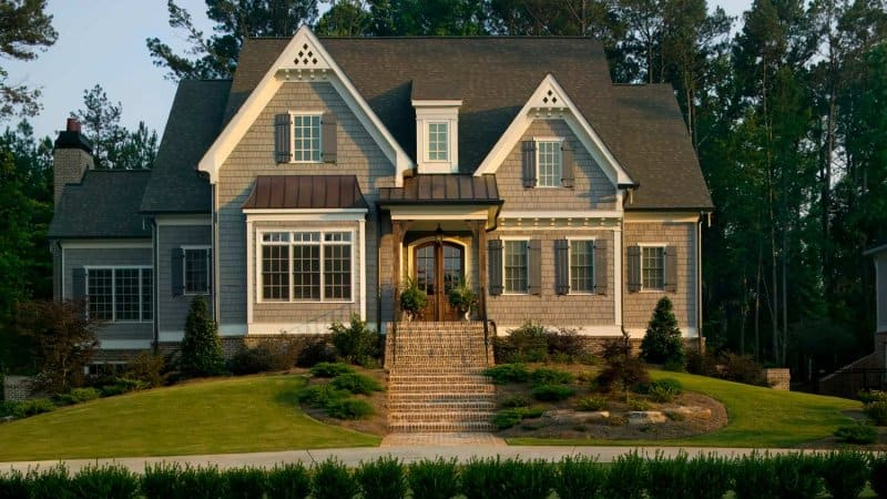 A suburban house with landscaped lawn (Photo by Phillip Spears/DigitalVision - stock.adobe.com)